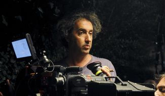 "FILE - This undated file photo made available by the press office Punto e Virgola shows, Italian director Paolo Sorrentino on the set of his movie ""La grande bellezza"" (The Great Beauty). The film is nominated for an Academy Award for best foreign picture. The 86th Academy Awards will be held on March 2, 2014, in Los Angeles. (AP Photo/Punto e Virgola Press Office, Gianni Fiorito, file)"