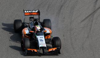Formula One driver Sergio Perez of Force India speeds down the track during pre-season testing at the Bahrain International Circuit in Sakhir, Bahrain, on Thursday, Feb. 27, 2014. (AP Photo/Hasan Jamali)