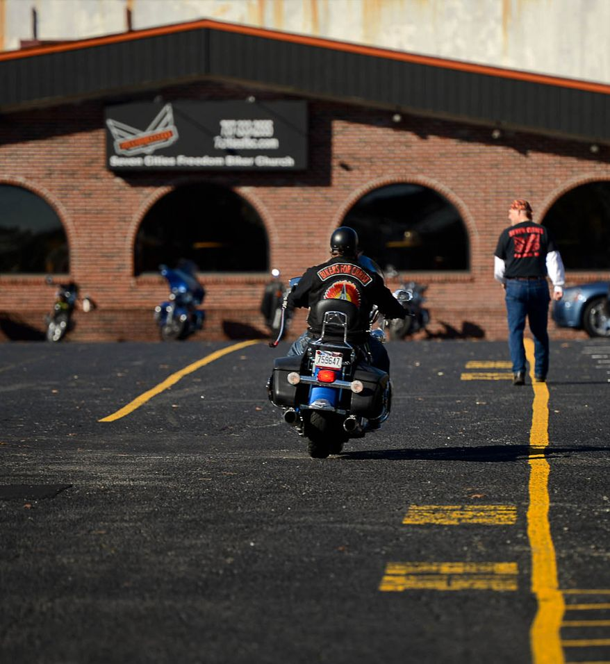 A biker arrives for Sunday prayer circle at Freedom Biker Church, Chesapeake, Va., Sunday February 23, 2014. Andrew Harnik/The Washington Times