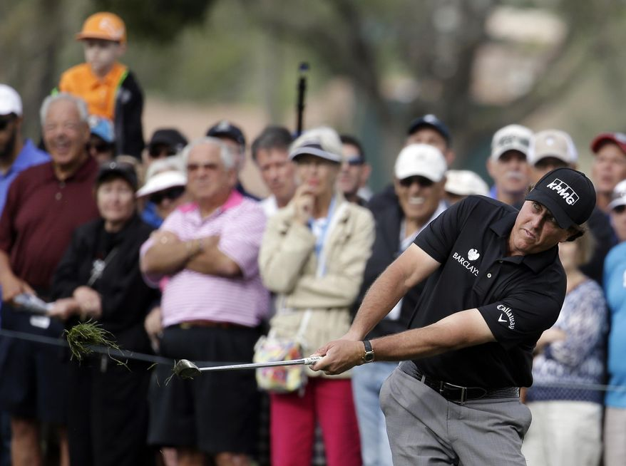 Phil Mickelson hits onto the 16th green during the second round of the Honda Classic golf tournament, Friday, Feb. 28, 2014, in Palm Beach Gardens, Fla. (AP Photo/Lynne Sladky)