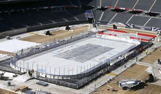 Work continues to transform Soldier Field for Saturday's Stadium Series NHL hockey game between the Chicago Blackhawks and the Pittsburgh Penguins, Thursday, Feb. 27, 2014, in Chicago. . (AP Photo/Charles Rex Arbogast)