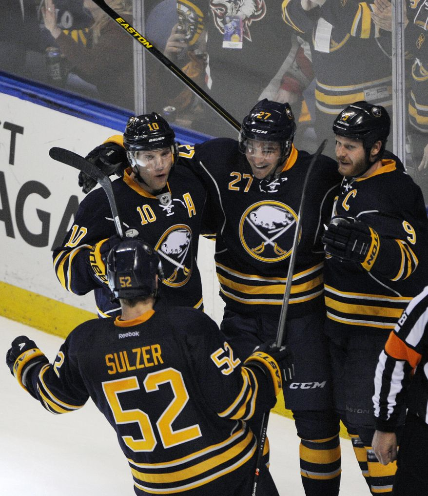 Buffalo Sabres' Alexander Sulzer (52) celebrates with teammates Christian Ehrhoff (10), Matt D'Agostini (27) and Steve Ott (9) after D'Agostini scored the game-winning goal in the overtime session against the  Boston Bruins during an NHL hockey game in Buffalo, N.Y., Wednesday, Feb. 26,  2014. Buffalo won 5-4. (AP Photo/Gary Wiepert)
