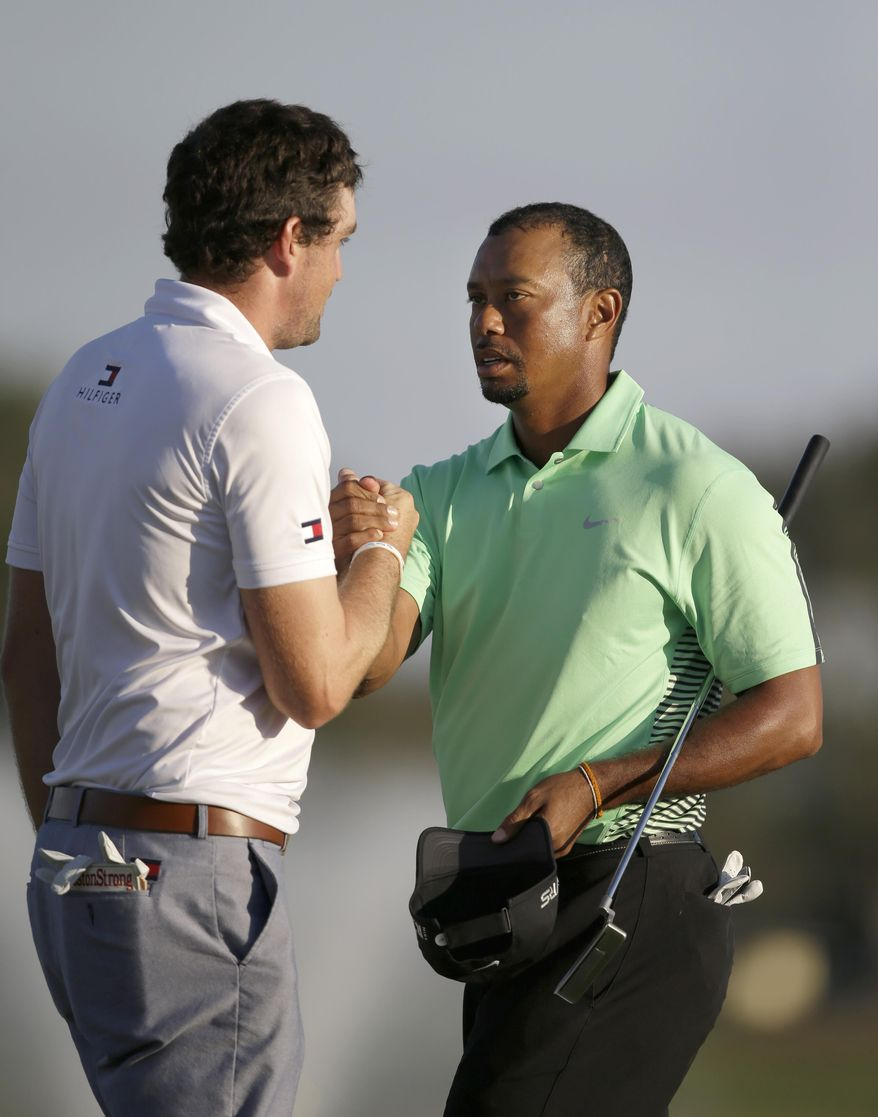 Tiger Woods, right, and Keegan Bradley congratulate each other after finishing the second round of the Honda Classic golf tournament, Friday, Feb. 28, 2014, in Palm Beach Gardens, Fla. (AP Photo/Wilfredo Lee)
