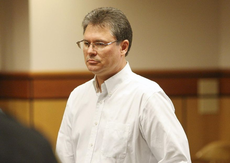 This Aug. 26, 2013 photo shows Stacey Rambold standing in a courtroom after sentencing by Judge G. Todd Baugh in Billings, Mont.  Attorneys for Rambold, a former Montana teacher who raped a 14-year-old student argued Friday, Feb. 28, 2014,  that his 30 days in prison were enough punishment, even as a judicial oversight panel sought the censure of Baugh, the judge in the case over what it called an unlawful sentence.  Prosecutors want to send freed rapist Stacey Dean Rambold of Billings back to prison. They say he should have served a minimum of four years after pleading guilty last year to sexual assault without consent.  (AP Photo/Billings Gazette, Paul Ruhter)