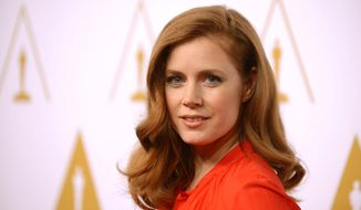 FILE - In this Monday, Feb. 10, 2014 file photo, Amy Adams arrives at the 86th Oscars Nominees Luncheon, in Beverly Hills, Calif. Adams mixed show business with shoe business at Oscar rehearsals. The Oscar presenter and nominee arrived at the Dolby Theatre in Los Angeles Friday, Feb. 28, 2014, in practical rain boots, which she instantly traded for sky-high silver stilettos. (Photo by Jordan Strauss/Invision/AP, file)