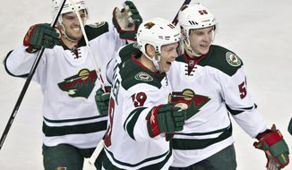 Minnesota Wild's Torrey Mitchell (17), Stephane Veilleux (19) and Erik Haula (56) celebrate a goal against the Edmonton Oilers during second period NHL hockey action in Edmonton, Canada, Thursday, Feb. 27, 2014. (AP Photo/The Canadian Press, Jason Franson)