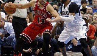 Chicago Bulls center Joakim Noah (13) tries to get around Dallas Mavericks guard/forward Vince Carter during the first half of an NBA basketball game on Friday, Feb. 28, 2014, in Dallas. (AP Photo/John F. Rhodes)