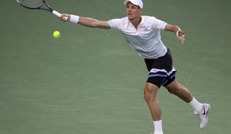 Tomas Berdych of the Czech Republic returns the ball to Philipp Kohlschreiber of Germany during a semi final match of the Dubai Duty Free Tennis Championships in Dubai, United Arab Emirates, Friday, Feb. 28, 2014. (AP Photo/Kamran Jebreili)