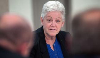 EPA Administrator Gina McCarthy discusses proposed regulations with coal industry leaders during an event Friday at Dakota Gasification Synfuels Plant in Beulah, N.D.  Friday, Feb. 28, 2014. McCarthy traveled to the state at the invitation of Democratic U.S. Sen. Heidi Heitkamp of North Dakota, who served as a member of the board of directors at the synthetic natural gas plant in Beulah until she was elected senator in 2012. (AP Photo/Kevin Cederstrom)