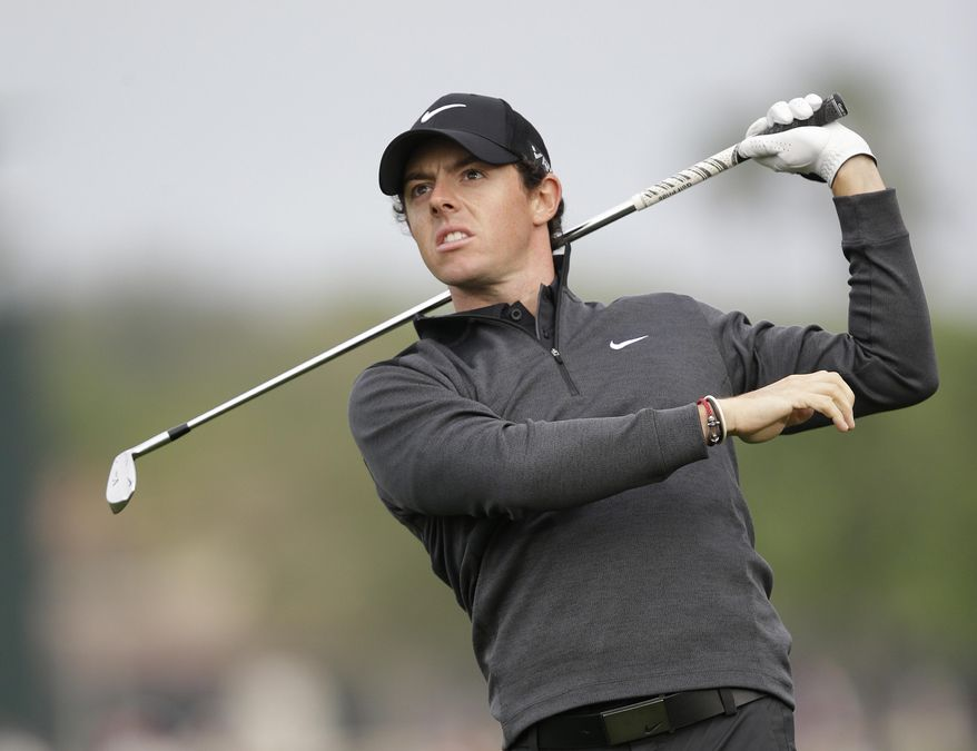 Golfer Rory McIlroy of Northern Ireland, watches his shot on the 12th hole during the second round of the Honda Classic golf tournament, Friday, Feb. 28, 2014 in Palm Beach Gardens, Fla. (AP Photo/Wilfredo Lee)