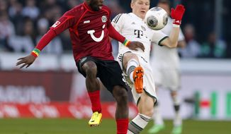 Bayern's Bastian Schweinsteiger, right, and Hannover's Mame Diouf of Senegal challenge for the ball during the German first division Bundesliga soccer match between Hannover 96 and Bayern Munich in Hannover, Germany, Sunday, Feb. 23, 2014. (AP Photo/Frank Augstein)
