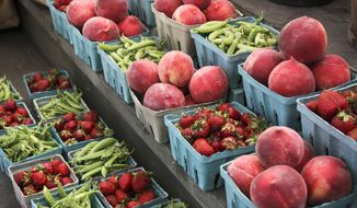 "Peaches, strawberries, and snap peas at a roadside market. ""Eat a wide variety of whole, natural foods (those unaltered by man),"" advises Dr. Angela Griffiths. (AP Photo/J. Scott Applewhite)"