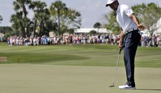 Tiger Woods reacts after his putt falls short on the 18th green during the third round of the Honda Classic golf tournament, Saturday, March 1, 2014, in Palm Beach Gardens, Fla. (AP Photo/Lynne Sladky)