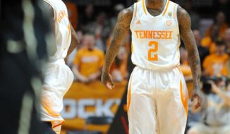 Tennessee guard Antonio Barton (2) celebrates after hitting two three-pointers against Vanderbilt during the first half of an NCAA basketball game at the Thompson-Boling Arena in Knoxville, Tenn. on Saturday, March 1, 2014. (AP Photo/Knoxville News Sentinel, Adam Lau)