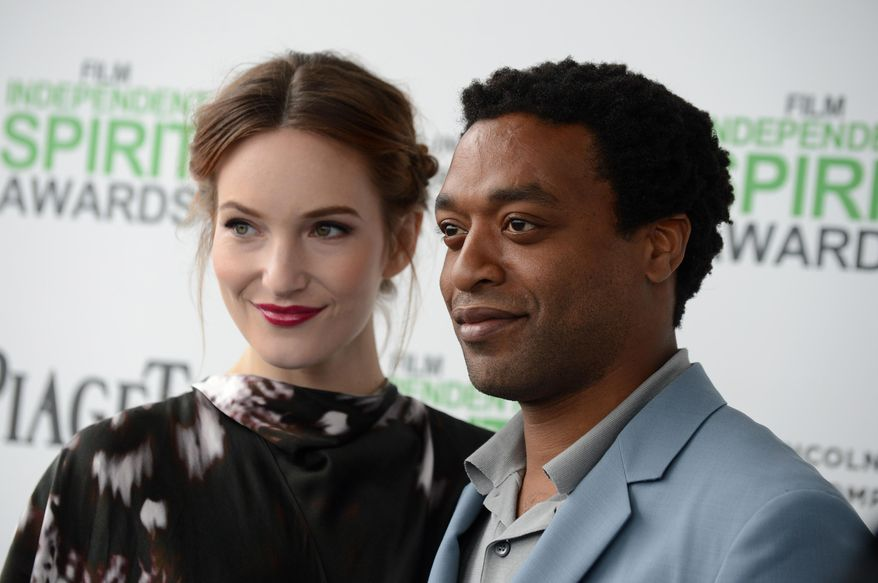 Sari Mercer, left, and Chiwetel Ejiofor arrive at the 2014 Film Independent Spirit Awards, on Saturday, March 1, 2014, in Santa Monica, Calif. (Photo by Jordan Strauss/Invision/AP)