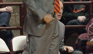 Virginia Tech's  head coach James Johnson yells to his players against North Carolina during the first half of an NCAA college basketball game, Saturday, March 1, 2014, in Blacksburg, Va. (AP Photo/Don Petersen)