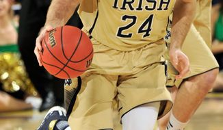 Notre Dame guard Pat Connaughton heads up court in the first half of an NCAA college basketball game with Pittsburgh,  Saturday, March 1, 2014, in South Bend, Ind. (AP Photo/Joe Raymond)