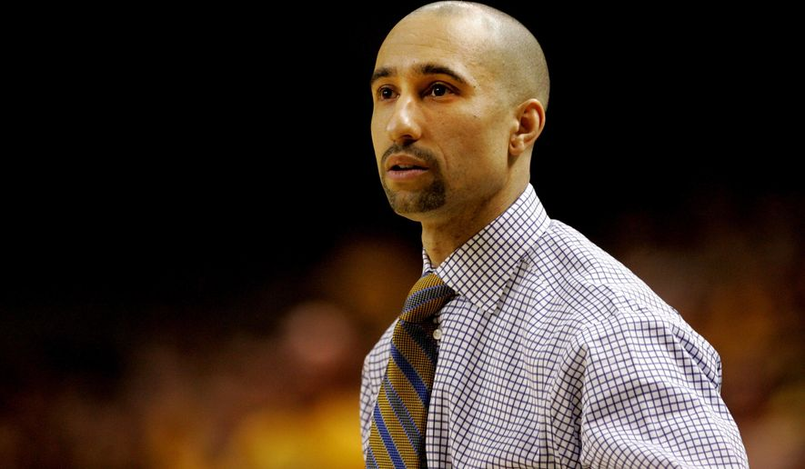 VCU head coach Shaka Smart looks on during the first half of an NCAA college basketball game against Saint Louis, Saturday, March 1, 2014, in Richmond, Va. (AP Photo/Jason Hirschfeld)