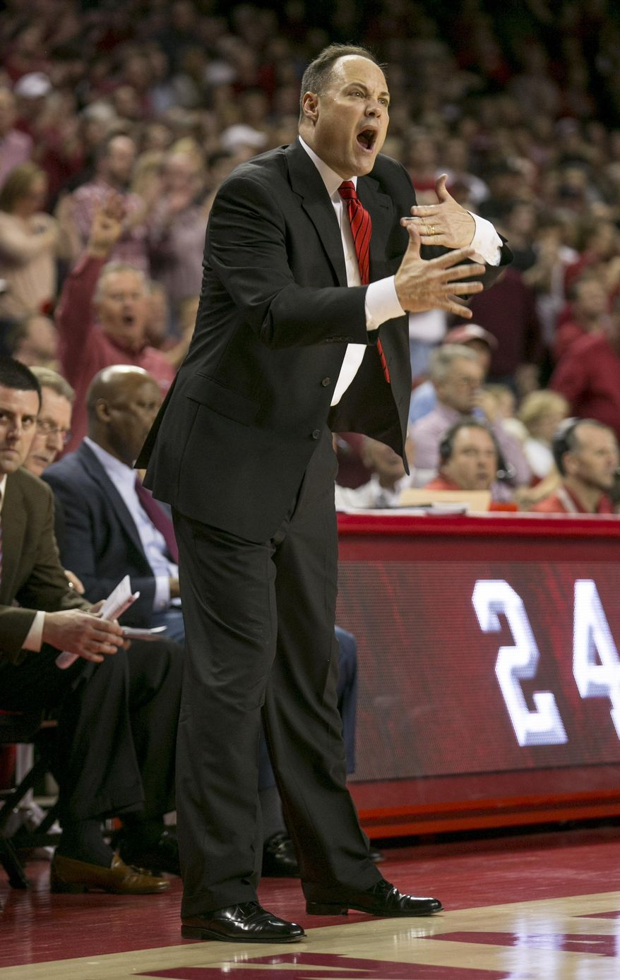 Georgia head coach Frank Martin yells at the referee about a foul call during the first half of an NCAA college basketball game against Arkansas on Saturday, March 1, 2014, in Fayetteville, Ark. (AP Photo/Gareth Patterson)
