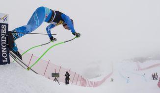 Tina Maze of Slovenia starts a training run for the women's alpine skiing World Cup downhill race in Crans-Montana, Switzerland, Thursday, Feb. 27, 2014. (AP Photo/Keystone, Jean-Christophe Bott)