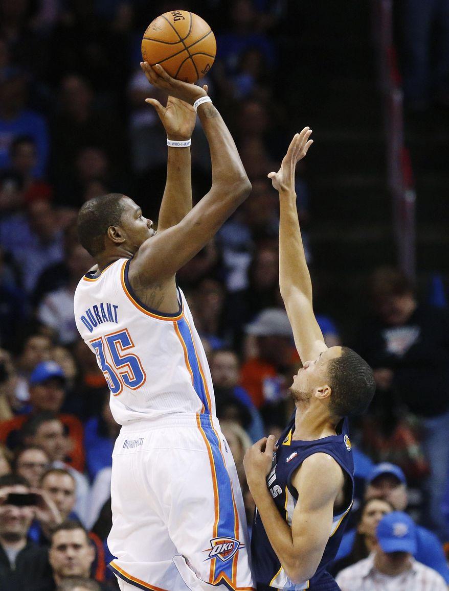 Oklahoma City Thunder forward Kevin Durant (35) shoots over Memphis Grizzlies forward Tayshaun Prince (21) during the first quarter of an NBA basketball game in Oklahoma City, Friday, Feb. 28, 2014. The Thunder won 113-107. (AP Photo/Sue Ogrocki)