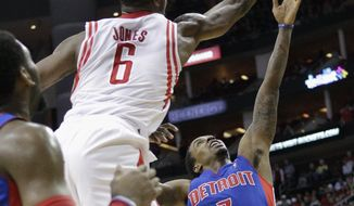 Detroit Pistons guard Brandon Jennings (7) has his shot blocked by Houston Rockets' Terrence Jones (6) during the first half of an NBA basketball game, Saturday, March 1, 2014, in Houston. (AP Photo/Bob Levey)