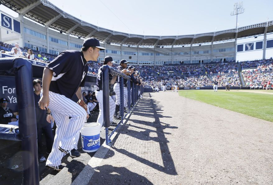 New York Yankees pitcher Masahiro Tanaka runs out of the dugout before pitching in the fifth inning of an exhibition baseball game against the Philadelphia Phillies Saturday, March 1, 2014, in Tampa, Fla. (AP Photo/Charlie Neibergall)