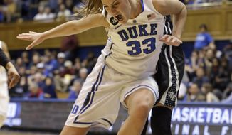 Duke's Haley Peters (33) loses the ball as Wake Forest's Dearica Hamby defends during the first half of an NCAA college basketball game in Durham, N.C., Thursday, Feb. 27, 2014. (AP Photo/Gerry Broome)