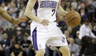 FILE -- In this Jan. 12, 2014, file photo, Sacramento Kings guard Jimmer Fredette looks to pass during an NBA basketball game against the Cleveland Cavaliers in Sacramento, Calif. The Kings announced they have completed a buyout of Fredette's contract, the team said Thursday, Feb. 27, 2014, clearing the way for the former BYU sensation to become a free agent. (AP Photo/Rich Pedroncelli, file)