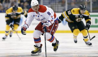 Washington Capitals' Alex Ovechkin (8) brings the puck up in the third period of an NHL hockey game against the Boston Bruins in Boston, Saturday, March 1, 2014. The Capitals won 4-2. (AP Photo/Michael Dwyer)