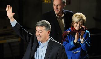 Colorado Republican Congressman Cory Gardner waves to supporters at an event to officially announce his candidacy for the U.S. Senate at Denver Lumber Company on Saturday, March 1, 2014, in Denver. Gardner will run against Democratic Sen. Mark Udall. (AP Photo/Chris Schneider)