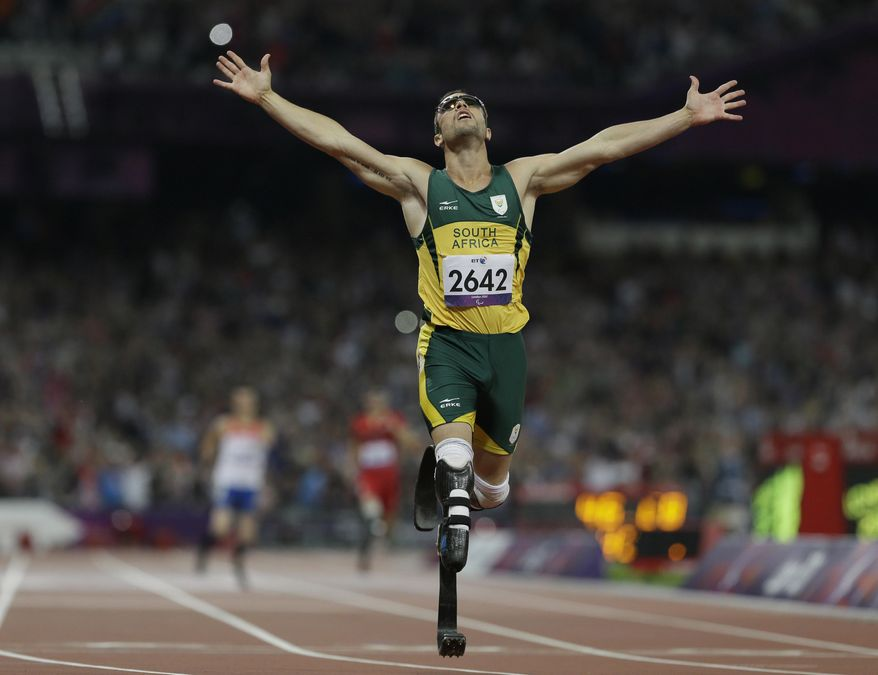 FILE: In this Saturday, Sept. 8, 2012  South Africa's Oscar Pistorius wins gold in the men's 400-meter T44 final at the 2012 Paralympics, in London. Pistorius, now 27, faces possibly being sent to prison until he is older than 50 for the shooting death of his girlfriend Reeva Steenkamp. Pistorius goes on trial Monday March 3, 2014. (AP Photo/Kirsty Wigglesworth-File)