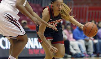 Louisville guard Antonita Slaughter (4) drives against Cincinnati forward Jeanise Randolph (33) during the first half of an NCAA  college basketball game, Saturday, March 1, 2014, in Cincinnati. (AP Photo/David Kohl)