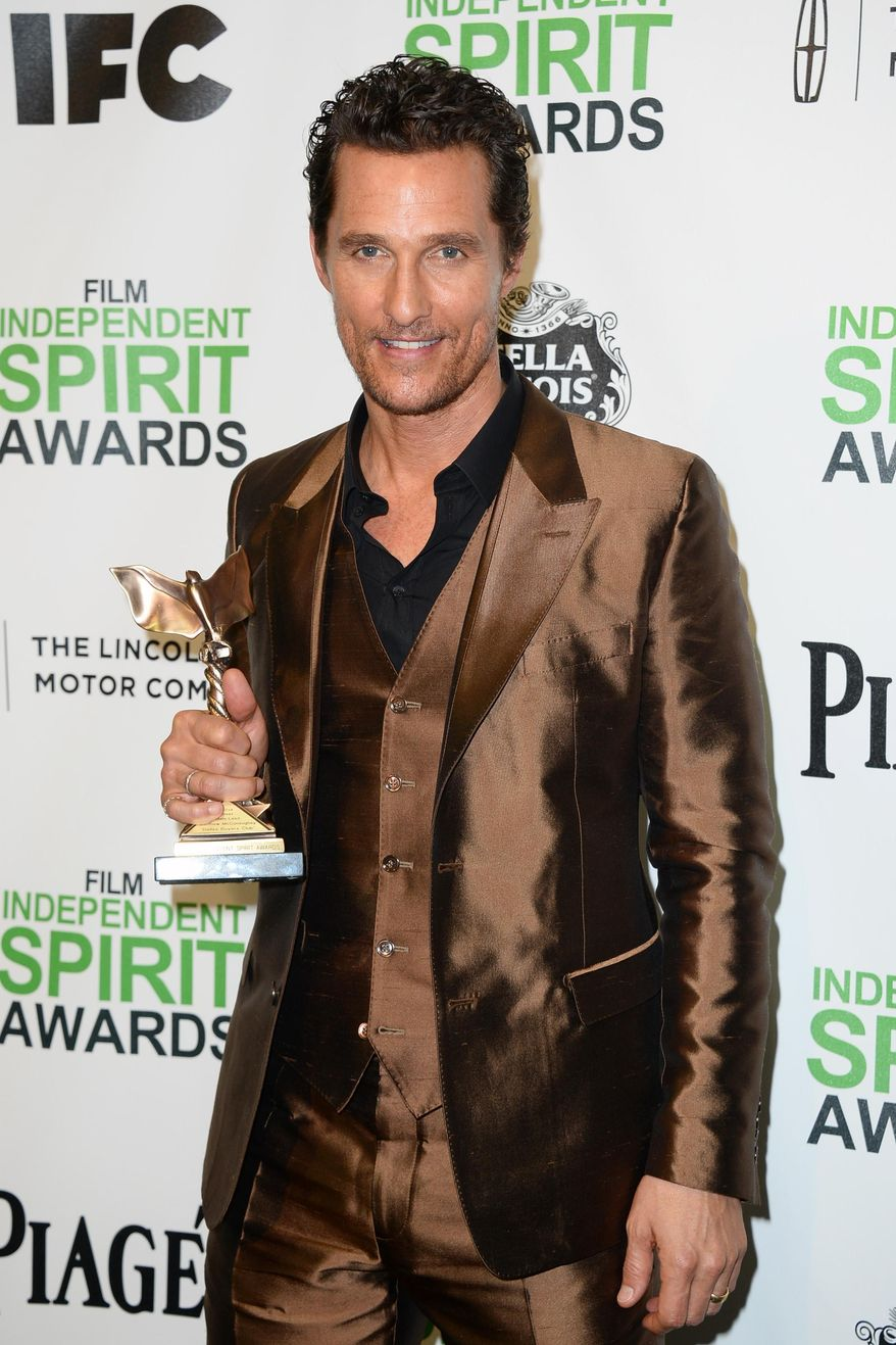 """Matthew McConaughey poses with the award for best male lead for """"Dallas Buyers Club"""" in the press room at the 2014 Film Independent Spirit Awards, on Saturday, March 1, 2014, in Santa Monica, Calif. (Photo by Jordan Strauss/Invision/AP)"""