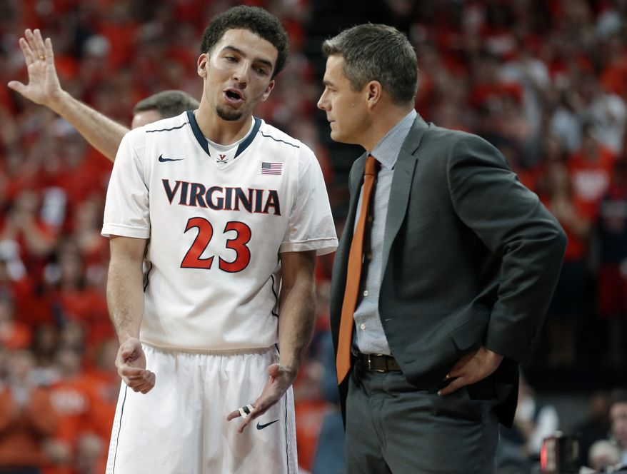 Virginia guard London Perrantes (23) talks with  head coach Tony Bennett during the second half of an NCAA College basketball game in Charlottesville, Va., Saturday, March 1, 2014. Virginia won the game 75-56. (AP Photo/Steve Helber)