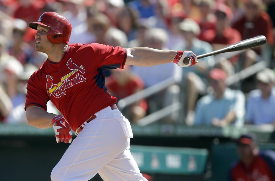 St. Louis Cardinals' Matt Holliday watches his RBI-double during the third inning of a spring exhibition baseball game against the New York Mets, Sunday, March 2, 2014, in Jupiter, Fla. (AP Photo/Jeff Roberson)