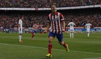 Atletico's Koke celebrates his goal during a Spanish La Liga soccer match between Atletico de Madrid and Real Madrid at the Vicente Calderon stadium in Madrid, Spain, Sunday, March 2, 2014. (AP Photo/Gabriel Pecot)