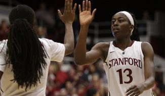 Stanford's Chiney Ogwumike, right, celebrates with Lili Thompson during the second half of an NCAA college basketball game against Washington State Saturday, March 1, 2014, in Stanford, Calif. (AP Photo/Ben Margot)