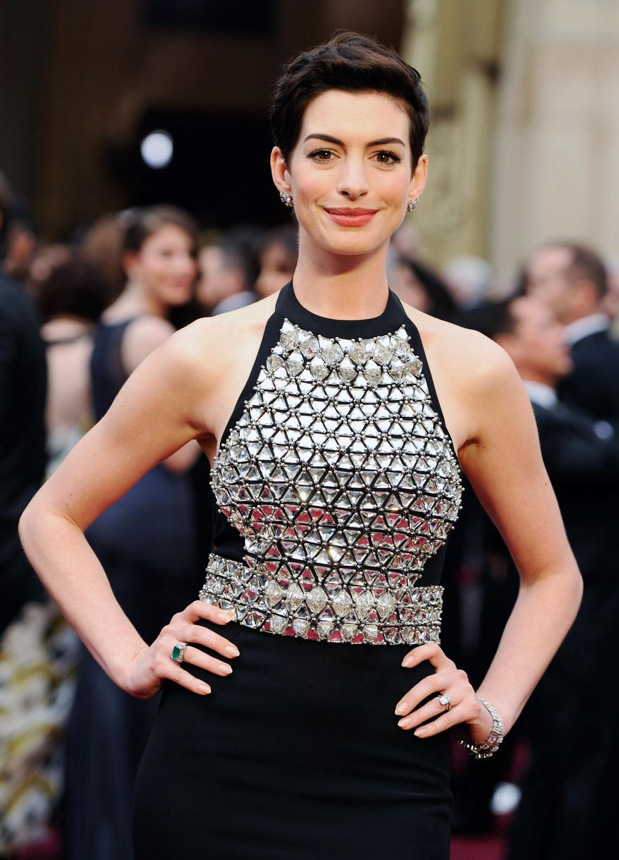 Anne Hathaway arrives at the Oscars on Sunday, March 2, 2014, at the Dolby Theatre in Los Angeles.  (Photo by Chris Pizzello/Invision/AP)