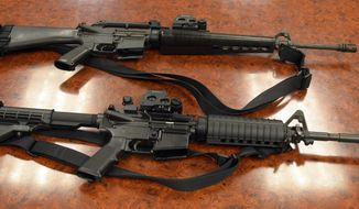 A Thursday, Feb. 20, 2014, photo shows two M-16 rifles. (AP Photo/The Salt Lake Tribune, Rick Egan) ** FILE **