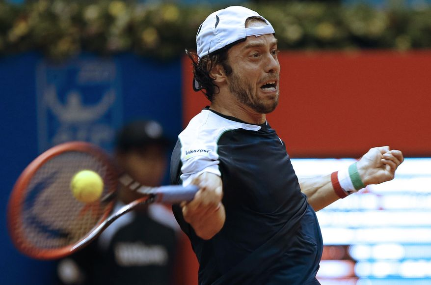 Italy's Paolo Lorenzi returns the ball to Argentina's Federico Delbonis during the Brazil Open ATP tournament final tennis match in Sao Paulo, Brazil, Sunday, March 2, 2014. (AP Photo/Andre Penner)