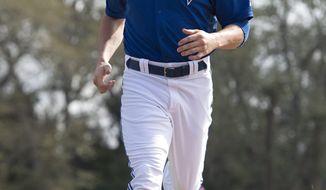 Toronto Blue Jays Colby Rasmus runs during a base running drill at baseball spring training in Dunedin, Fla., Tuesday, Feb. 25, 2014. (AP Photo/The Canadian Press, Frank Gunn)
