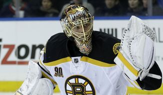Boston Bruins goalie Tuukka Rask makes a save during the second period of the NHL hockey game against the New York Rangers, Sunday, March 2, 2014, in New York. (AP Photo/Seth Wenig)