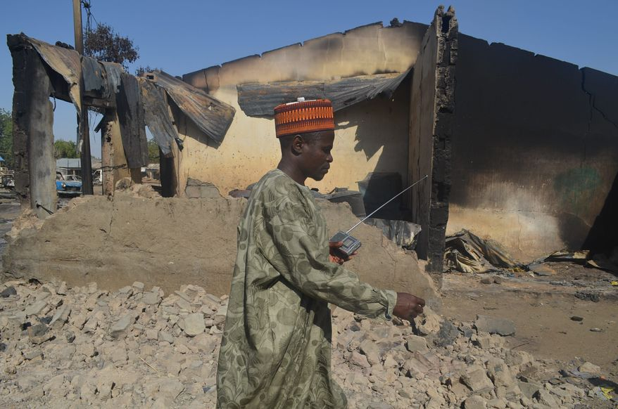 "IN TERRORISTS' WAKE: Boko Haram has burned buildings and inflicted other horror in northeastern Nigeria on its quest to spread Shariah law. An analyst says the governments in Cameroon and Niger ""are scared to death."" (Associated Press)"