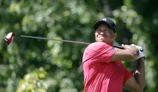 Tiger Woods tees off on the third hole during the final round of the Honda Classic golf tournament on Sunday, March 2, 2014, in Palm Beach Gardens, Fla. (AP Photo/Wilfredo Lee)