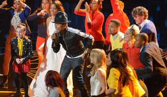 """Pharrell Williams, center, performs """"Happy"""" during the Oscars at the Dolby Theatre on Sunday, March 2, 2014, in Los Angeles.  (Photo by John Shearer/Invision/AP)"""