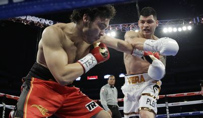 Julio Cesar Chavez Jr., left, and Bryan Vera, right, trade punches during a 12-round super middleweight bout, Saturday, March 1, 2014, in San Antonio. Chavez won by decision. (AP Photo/Eric Gay)