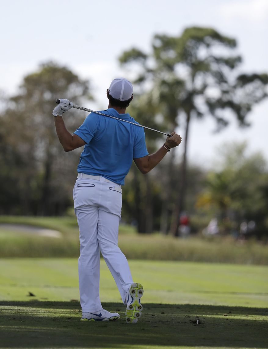 Rory McIlroy, of Northern Ireland, watches after hitting from the seventh tee during the final round of the Honda Classic golf tournament on Sunday, March 2, 2014, in Palm Beach Gardens, Fla. (AP Photo/Lynne Sladky)
