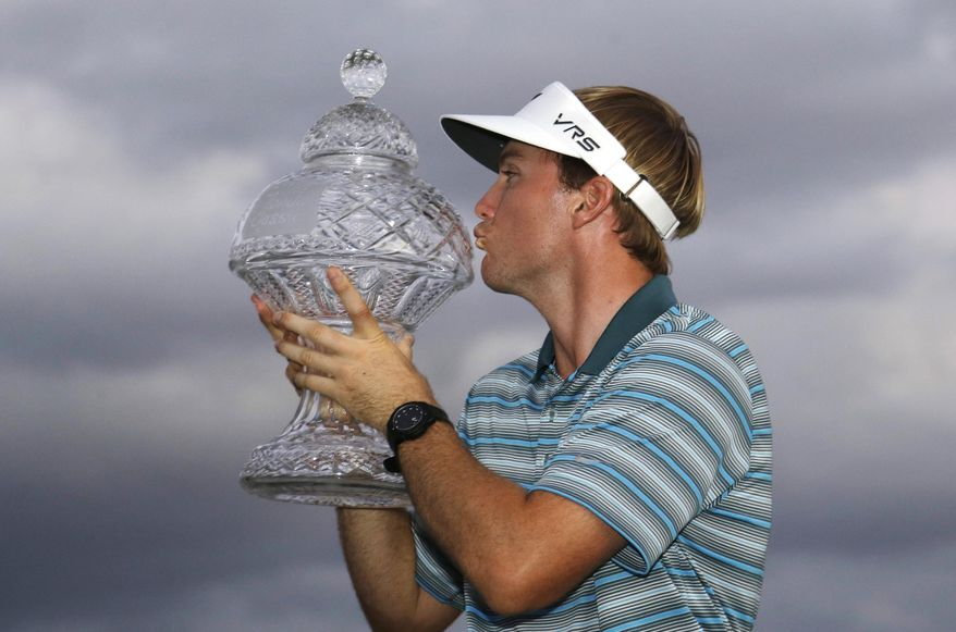 Russell Henley kisses the trophy after winning the Honda Classic golf tournament, Sunday, March 2, 2014 in Palm Beach Gardens, Fla. (AP Photo/Wilfredo Lee)