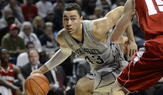 Penn State's Ross Travis (43) works around Wisconsin's Sam Dekker (15) during the first half of a NCAA college basketball game on Sunday, March 2, 2014, in State College, Pa. (AP Photo/Ralph Wilson)